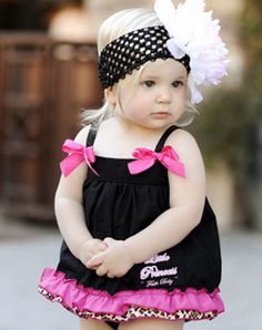 Black swing top with a pink and leopard ruffle.
