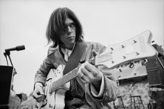 Dec. 1969, San Diego | Neil Young plays his Gretsch White Falcon during a sound check at Balboa Stadium before a Crosby, Stills, Nash & Young concert. | Image by Henry Diltz