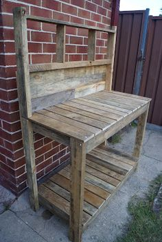 Pallet potting table. Put lattice or chicken wire on the back so plants can attach themselves and grow up it.