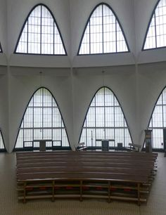 Large arched windows allow for abundant light throughout the space.