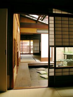 love tatami floors, they smell good.  Love the little walkway around the edges of the house...
