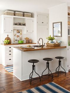 I like the simplicity of the white units, wooden counter, the simple stools don't intrude. Simple sink in the breakfast bar.