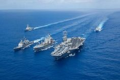 nothing says it like a U.S. Navy carrier strike group!