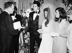 A 21 year old Priscilla Ann Wagner married Elvis Presley in where else but Las Vegas Nevada, on May 1, wearing a beautiful floor length, long sleeved wedding dress, that she reportedly designed herself. It was made of white silk chiffon, with beaded yoke, trimmed in seed pearls and Priscilla's look was completed by a three-foot tulle veil topped by a rhinestone crown (what else for the Queen consort of Rock'n'Roll).