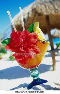 Tropical Fruit Drink in Front of a Bar at a Beach