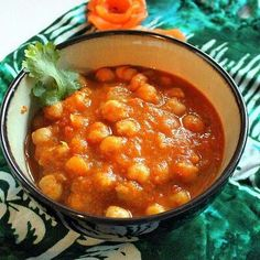 Chana Masala, Pressure Cooked.  Ingredients: 2 teaspoons oil 1/2 medium onion chopped 1/2 teaspoon cumin powder 1/4 teaspoon turmeric powder pinch of asafetida(hing) 3 medium tomatoes 1 inch ginger chopped (can be substituted with ginger paste) 3-4 cloves of garlic peeled and chopped (can be substituted with garlic paste) 1/2 teaspoon red chili flakes or green chili, to taste 1 teaspoon lemon juice 1 can garbanzo beans washed and drained or 1 cup dry chickpeas soaked overnight and pressure…