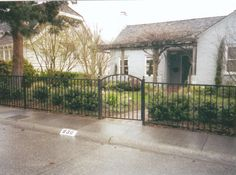 I love the idea of a wrought iron fence. I especially love that the gate on this one is curved. I like that wrought iron fences provide extra security, but still look great. I will have to look into having one installed.