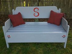 The secret of this handsome bench? It was made from a discarded headboard.
