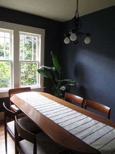 Red House West - dark blue dining room painted with Miller Evolution paint in Nova