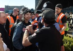 In a second image, Saffiyah Khan was seen smiling at the EDL leader (PA)