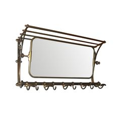 Brass luggae rack and mirror - Vintage railway luggage rack with coat hooks and hall mirror.