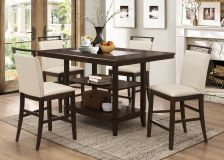Friends and family will love to gather around this lovely Catherine 5 Pcs Counter Height Dining Set. It is great to gather around this dining table for dinners or for a cup of coffee in the morning. The table is finished in an espresso finish with a smoked glass center. The chairs are upholstered in a beige faux leather color. The table stands on a pedestal that comes with 2 shelves for storage.