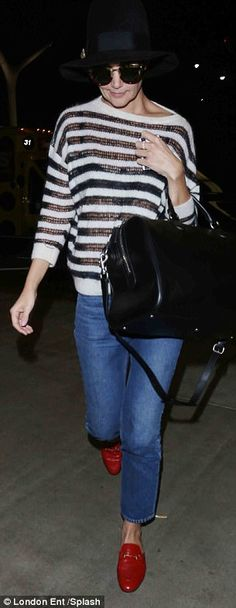Yummy mummy: Katie wowed in a striped sweater, which the mother-of-one paired with skinny ...
