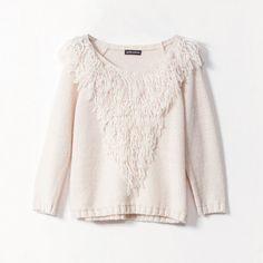 Le pull en laine frangé