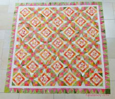 celtic solstice mystery quilt 2013 from bonnie hunter, by frances on the fabadashery blog, in lovely pinks, greens, & oranges