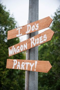 Country wedding direction signs.