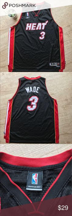 """Reebok Miami Heat Dwayne Wade Swingman Jersey * Reebok Miami Heat Dwayne Wade # 3 Swingman Jersey * 100% Authentic  * Length + 2 * LENGTH - 32"""" front/ 34"""" back * ARMPIT to ARMPIT - 25.5"""" * ARM OPENING - 12"""" * 100% Polyester * please note, this item is in PRELOVED condition. #3 patch (on back) is slightly faded, please expect normal pilling.  * otherwise in good used condition     * no trades/paypal/off cite transactions  * all measurements are approximate Reebok Shirts Tank Tops"""
