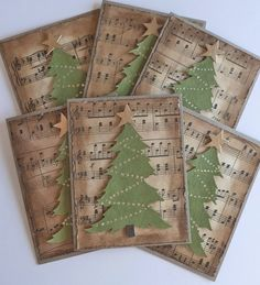 handmade Christmas cards ... Vintage look with upcycled sheet music stained and tattered ... die cut tree with garlands of gold dots ....