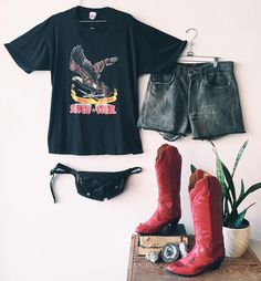 "Ride into the sunset in this rough and tumble outfit! // Mac Tools Super Steel black t-shirt with eagle. 42"" bust 27"". $54. // Levi's grey denim cut off shorts. 30"" waist 4"" inseam 11"" rise. $46. Tony Llama tall cowboy boots withered leather uppers and red snakeskin lowers. Size 8. $178. // Black leather fanny pack with zipper compartment. $46. // To purchase call the store  at 512-524-0166 and pay over the phone or comment below with your email and let us know if you will pick up in the…"