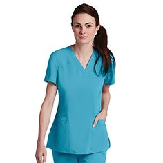 Feel light and breezy in this Barco One™ Women's V-Neck Perforated Side Panel Solid Scrub Top. Innovative perforated panels let air easily flow so you stay cool and dry. #scrubs #scrubstyle #bluescrubs