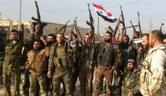 Syrian government troops celebrate victory