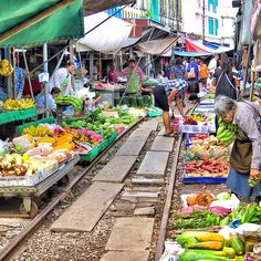 It's a market. It's a railway. It's a street? Maeklong is indeed all of these. One moment the stalls are bustling with locals picking up everyday groceries from fruits and veggies to frogs and eel. The next, a train horn blows in the distance, and stall keepers close the awnings and umbrellas and pull their displays back, as shoppers retreat from the tracks. Photo courtesy of reachjody on Instagram.