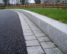 Silver Grey granite kerb and border installed with tarmac surfacing in Derrylin, Fermanagh. Resin Driveway, Asphalt Driveway, Stone Driveway, Gravel Driveway, Driveway Entrance Landscaping, Modern Driveway, Outdoor Landscaping, Driveway Ideas, Walkway