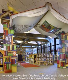 Southfield, Michigan Public Library - A giant book heralds the children's library area School Library Decor, Elementary School Library, Kids Library, Photo Library, Elementary Library Decorations, Preschool Library, Library Ideas, Bookstore Design, Library Book Displays