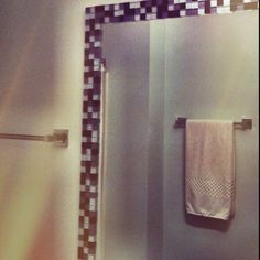 DIY - bathroom mirror update - glass tile, silicone glue and a lot of patience!