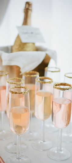 Add gold sugar to the trim of your champagne glasses to add an additional element of sophistication. #bridestheshow
