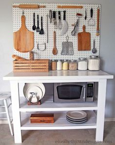 Kitchen - storage of utensils with the help of Pegboard