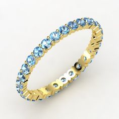 Rich & Thin Eternity Band - 14K Yellow Gold Ring with Blue Topaz | Gemvara