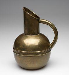 Attributed to Christopher Dresser, Scottish, 1834-1904. Jug, ca. 1880. Brass. Height: 19.1 cm (7 1/2 inches). Gift of Glenn Gissler 2009.106.3