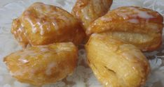 Thai Donuts - you know those warm, fluffy donuts dripping with sweet condensed milk you love at the Thai restaurants? Here's their well kept secret that they don't want you to know- the recipe is so easy!!!!