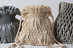Bags made from smoking embroidery combined with computational algorithms.