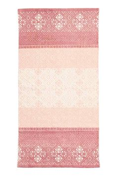 Bawełniany chodnik we wzory: Prostokątny chodnik z bawełnianej tkaniny we wzorzyste nadruki na wierzchu.