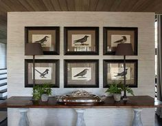 "Rare Johann Frisch bird prints hang above a long French console. ""I'm not one to put a small, skimpy thing along a big wall,"" designer Susan Ferrier says"