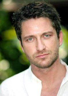 Gerard Butler, you can park your shoes under my bed anytime! YUM-E