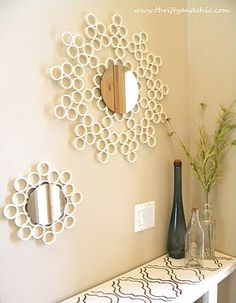 Mirrors decorated with cut PVC pipes. Tutorial included in the link. Also a lot of other nice ideas on this site!