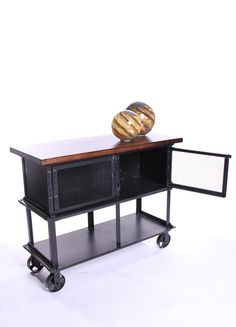 Industrial metal/iron utility cart with mango wood top.