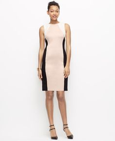 """Expertly seamed and colorblocked, this sleek piece flaunts the season's most notable neutrals - to put your best figure forward. Jewel neck. Sleeveless. Hidden back zipper with hook-and-eye closure. Back vent. Lined bodice, unlined skirt. 21 1/2"""" from natural waist."""