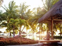 LUX* Le Morne, a hotel in Mauritius located in the southwest of the island, is sheltered by the Le Morne Brabant peak, a breathtaking UNESCO World Heritage Site. Mauritius Hotels, Sandy Beaches, 5 Star Hotels, World Heritage Sites, Patio, Island, Outdoor Decor, Spirit, Holiday