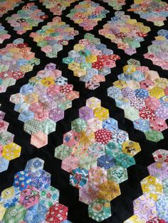 Hexagon UFO quilt top, Martha Washington setting I believe.  Made by Camille F.