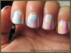 Watercolor sponged nail art.