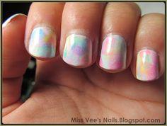 Watercolor sponged nail art.