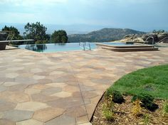 Nice custom stamping by Colorado Hardscapes on this pool deck. Also Bomanite Sandscaped and stained.