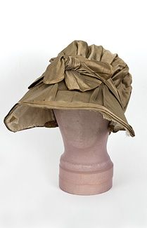 Regency bonnet..Regency silk bonnet, c.1805-1815 Neoclassical white dresses were accessorized with bonnets with elaborate designs. As you can see in this c.1810 fashion plate, a lady could choose from endless variations of shape and decoration to complement her simple Neoclassical columnar dress.