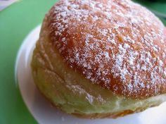 Berliner are fist-sized pastries, made from a sweet yeast-dough, and deep fried. They are filled with jam (such as raspberry, plum, apricot) or a vanilla cream (usually in Bavaria). They are topped with powdered sugar, granulated sugar, or icing.