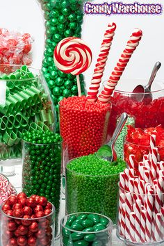 Christmas Candy Buffet - well that looks like a diabetic catastrophe and mighty expensive...but I won't lie - My eyes lit up like a child's when I saw this!
