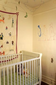 Home tour of Kate Lewis. Baby space. Drawings on the wall.